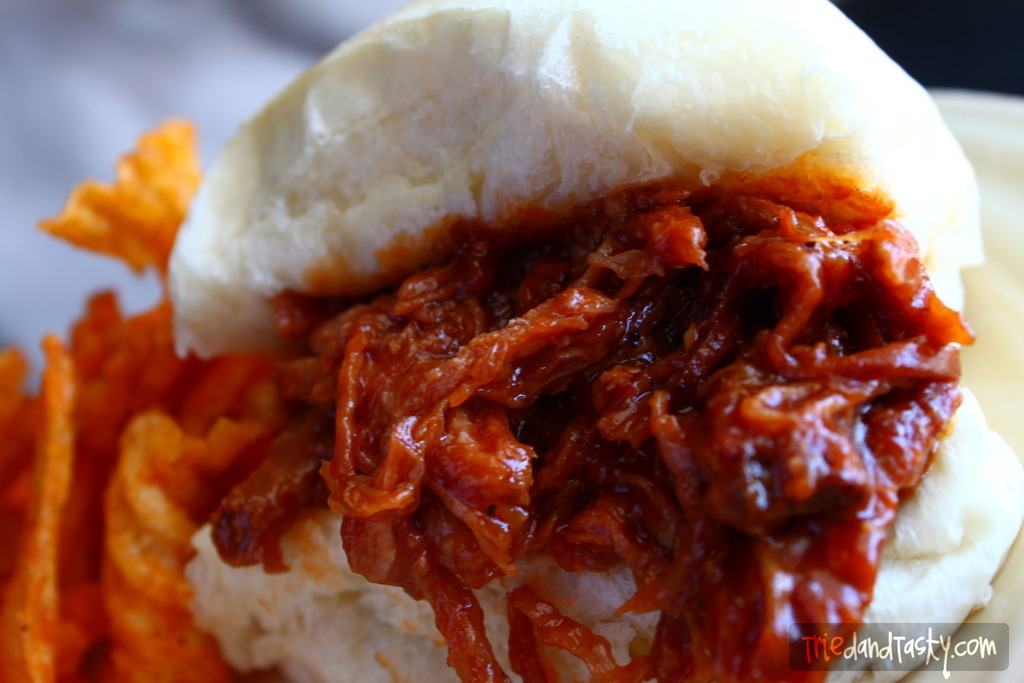 Crock Pot BBQ Pulled Pork // A saucy and delicious pulled pork that's great for sandwiches. Great recipe for BBQ's, picnics, and get togethers.   Tried and Tasty