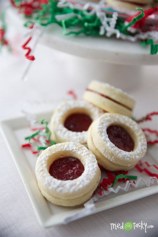 Raspberry-Filled Sugar Cookies with Lemon Zest // Even though the only lemon addition to this recipe is the zest, you'd be surprised what an impact it has.  These sugar cookies are amazing! | Tried and Tasty