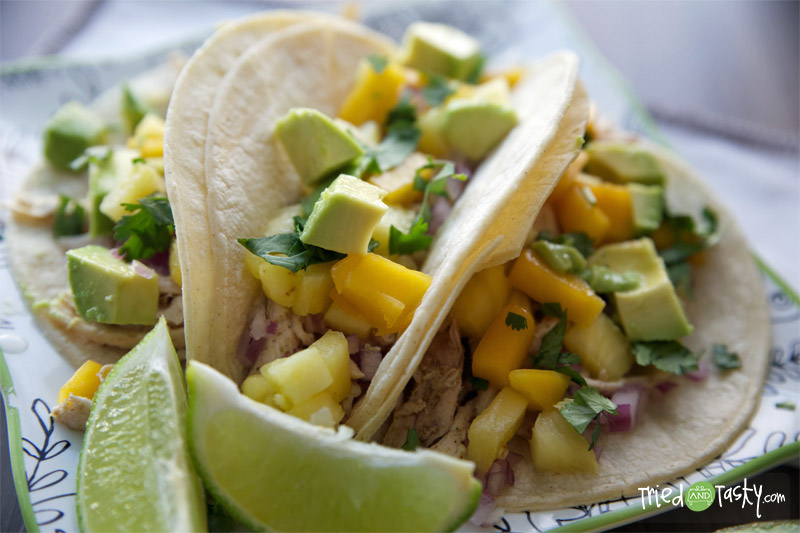 Chicken Tacos with Mango-Pineapple Salsa // These chicken tacos are probably in the top five favorite dish we've made to date. They are so light, so fresh, simply put: they are wonderful. Want to know what I love most about them? They are HEALTHY!   Tried and Tasty