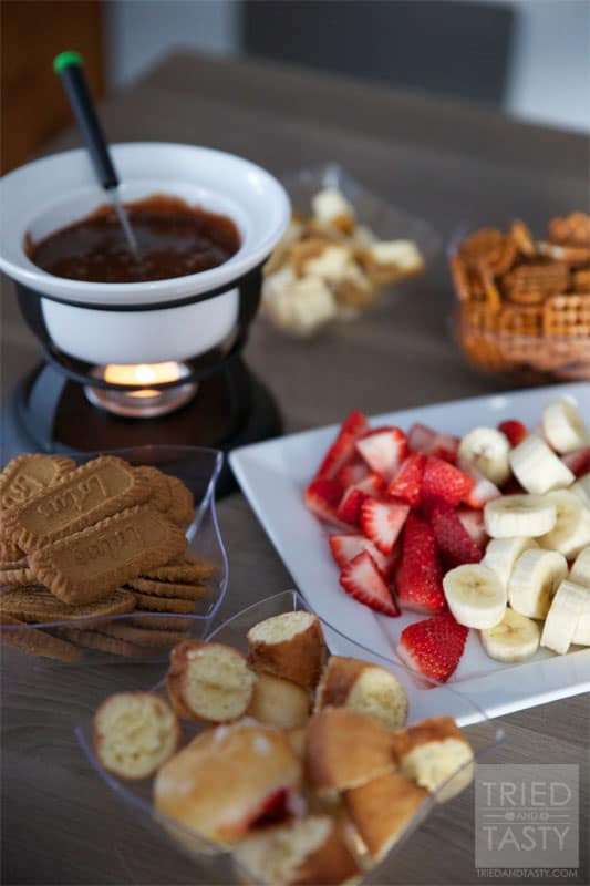 Chocolate Bar Fondue // This wonderful fondue pairs a delicious creamy cheese with sweet raspberries for an out of this world combination. You'll love the sweet surprise!   Tried and Tasty