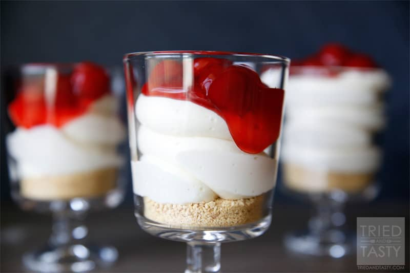 Cheesecake Parfaits // Not only are these Cheesecake Parfaits adorable, they are perfectly portioned.  Just keep them in the fridge until you're ready to serve! | Tried and Tasty
