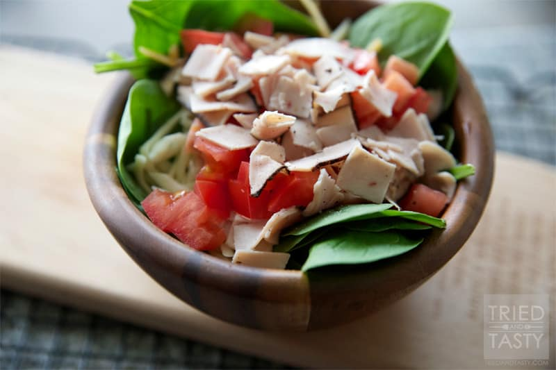 Turkey, Cheese & Tomato Spinach Salad // A quick & easy salad that is thrown together in no time! Sliced turkey breast is the star of the show, add in your favorite toppings and you've got a great lunch or side salad. | Tried and Tasty
