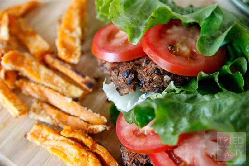 Lettuce-Wrapped Homemade Black Bean Veggie Burger // If you're looking for an alternative to the traditional grilled hamburger, why not give this Black Bean Veggie Burger a try? It's delicious, it's healthy, and it's easy to pull together. Make room on your grilling menu this season for this fantastic burger! | Tried and Tasty