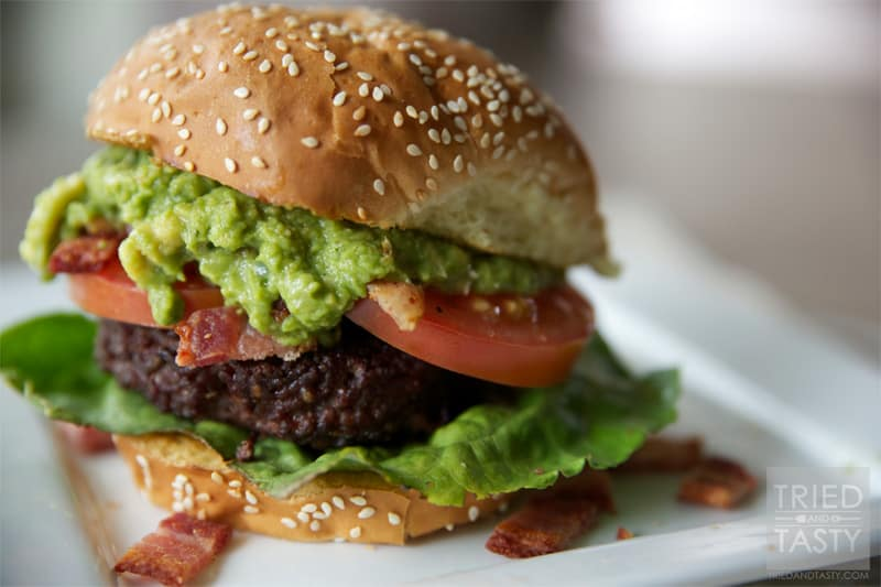 Guacamole Bacon Burger // If you love guacamole, you'll love this burger. It's got the wonderful flavors of guacamole paired with bacon on top of a well-seasoned grilled burger. You won't be disappointed!   Tried and Tasty