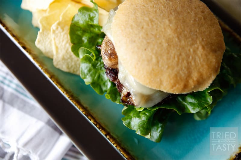 Sauteed Mushroom & Swiss Burger with Caramelized Onions // Nothing goes better with sautéed mushrooms than melty gooey Swiss cheese and a pile of sweet caramelized onions. Put all of that on top of a perfectly grilled burger and you've got yourself a fantastic sandwich!   Tried and Tasty