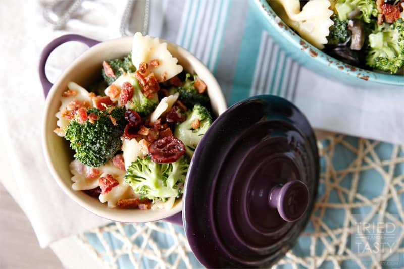Tasty Broccoli Salad with Dried Cranberries // Need a new salad to take to your next get together? This summery broccoli salad will be an instant hit. Slightly sweet with a little bit of tang, finished off with crunchy bacon bits. Delightful!  Tried and Tasty