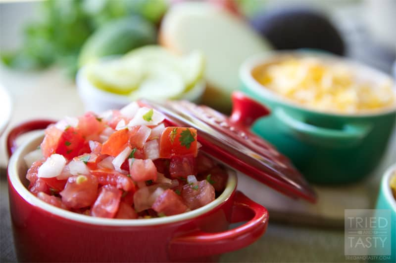 Pico de Gallo // Similar to salsa, Pico De Gallo is a fantastic condiment that can be served with any of your favorite Mexican dishes. Great as a topping on tacos, enchiladas, or salads. Perfect served with chips! Any way you dice it, this flavorful combo will add just what you need to your meal! | Tried and Tasty