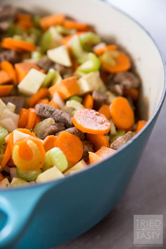Sweet Potato Beef Stew // This sweet potato stew is made perfectly slow cooker style in the Le Creuset 5 1/2 Qt. French Oven. A handful of healthy ingredients make for a delicious hearty and healthy meal. // Tried and Tasty
