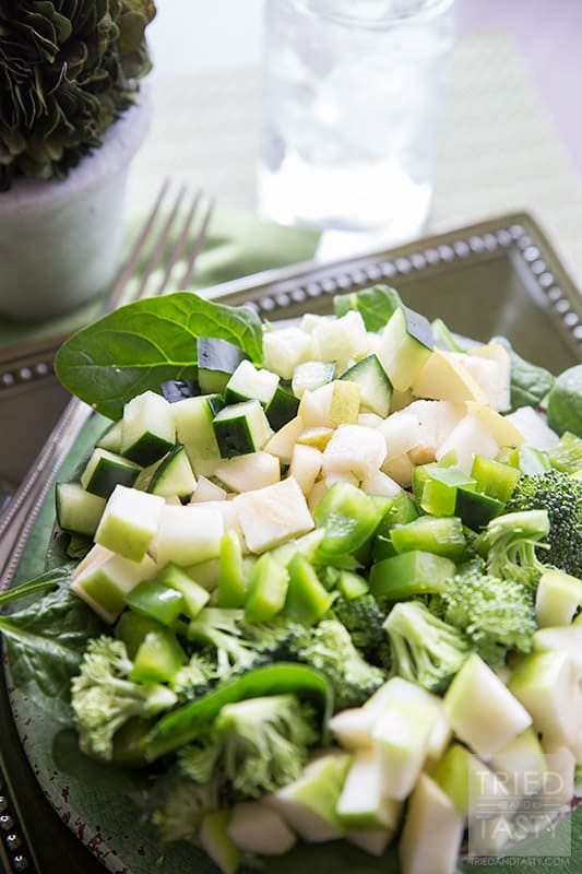 The Ultimate Green Salad // Ever thought of celebrating St. Patrick's Day and not sure what to eat that's nutritious and free of artificial food coloring? This would be an excellent GREEN meal (or starter) to serve to your family! All delicious fruits and vegetable served atop fresh spinach & drizzled with tasty tomatillo dressing. YUM! // Tried and Tasty