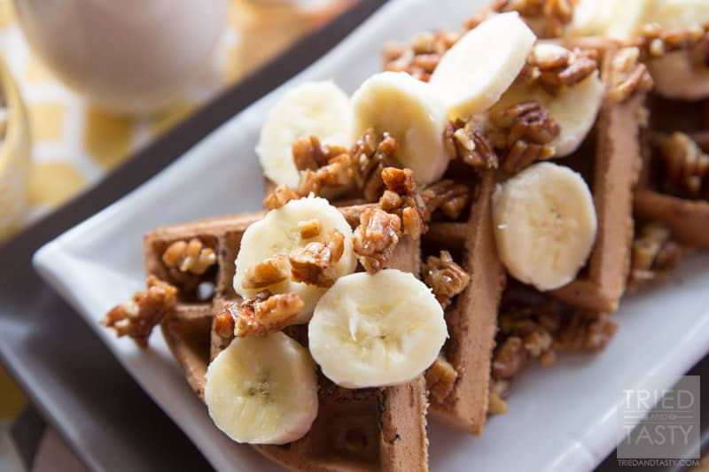Gluten Free Banana Nut Waffles // These healthy & delicious waffles are the perfect way to start your morning. Made with oat flour, you can have your favorite waffles without any wheat! Topped with maple candied pecans and bananas, they are a treat you don't want to miss!   Tried and Tasty