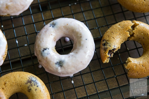 Baked Gluten Free Lemon Blueberry Doughnuts // If you are a doughnut lover but don't want all of the extra calories and sugar, give these baked doughnuts a try. With a little bit of citrus paired with plump & juicy blueberries - these are perfect for breakfast or dessert! | Tried and Tasty