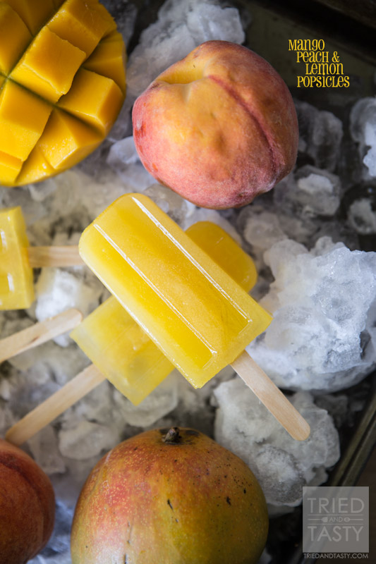 Mango Peach Lemonade Popsicles // Looking for a delicious sweet 'n tart frozen treat? Look no further, this is the popsicle for you! Made with no refined sugar - these are perfect for the whole family! | Tried and Tasty