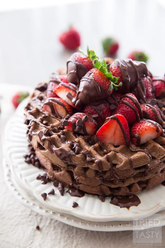 Whole Wheat Dark Chocolate Covered Strawberry Waffles // Looking for a fun new way to enjoy breakfast? Try these delicious chocolate waffles. The best part about them? They are actually not bad for you! You'll be surprised that they are made with whole wheat flour and no refined sugar! Drizzled with dark chocolate and covered with fresh strawberries. A beautiful way to start your morning! | Tried and Tasty