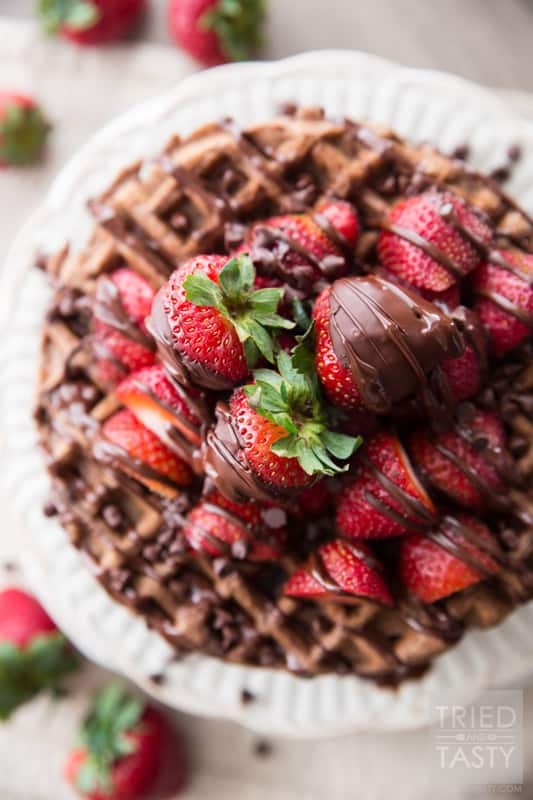 Whole Wheat Dark Chocolate Covered Strawberry Waffles // Looking for a fun new way to enjoy breakfast? Try these delicious chocolate waffles. The best part about them? They are actually not bad for you! You'll be surprised that they are made with whole wheat flour and no refined sugar! Drizzled with dark chocolate and covered with fresh strawberries. A beautiful way to start your morning!   Tried and Tasty