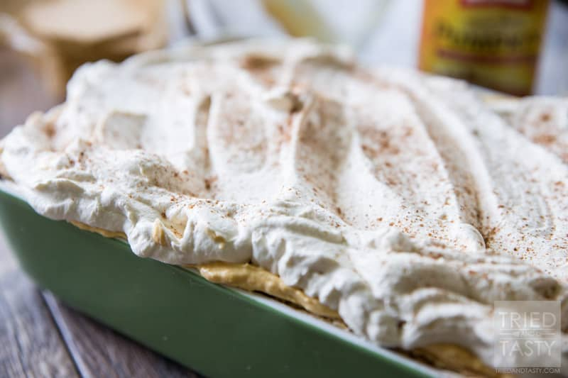 No Bake Pumpkin Cheesecake Icebox Cake // Made with only SIX simple ingredients this festive fall dessert is perfect for your parties and get togethers this season. Light, fluffy & not overly sweet you'll immediately fall in love with this treat! | Tried and Tasty