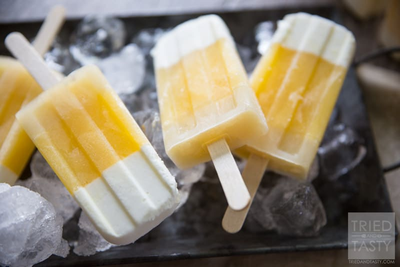 Tropical Candy Corn Popsicles // This 'candy corn' inspired treat is a healthy variation for all of your guilt-free treat needs! Perfectly tropical with the flavors of coconut, pineapple and orange you're tastebuds will say THANK YOU! | Tried and Tasty