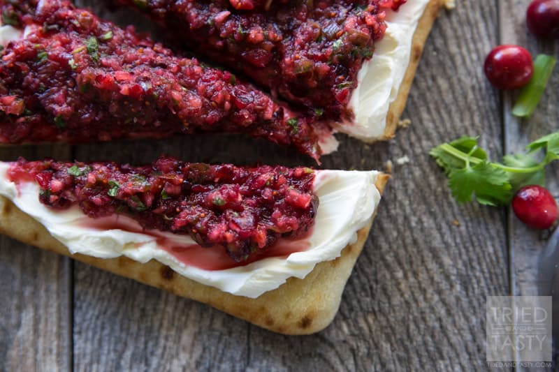 Cranberry Salsa Flatbread Appetizer // Want a delicious & festive appetizer for the holidays? You're in luck! This cranberry salsa will wow your guests tastebuds at first bite!   Tried and Tasty