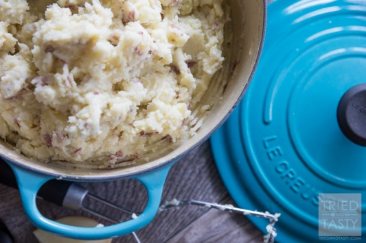 Dutch Oven Mashed Potatoes // Looking for a delicious but healthier mashed potato recipe? These out-of-this-world potatoes are made with only 4 ingredients and you won't believe the secret ingredient that makes them perfectly creamy! | Tried and Tasty