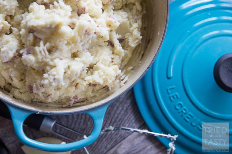 Dutch Oven Mashed Potatoes // Looking for a delicious but healthier mashed potato recipe? These out-of-this-world potatoes are made with only 4 ingredients and you won't believe the secret ingredient that makes them perfectly creamy!   Tried and Tasty