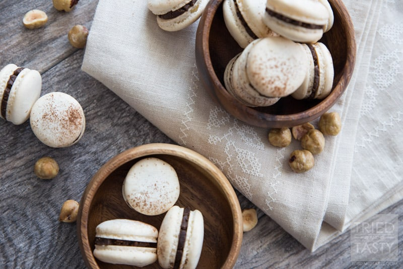 Classic French Macarons with Homemade Nutella Filling // These tasty little one-bite treats are made ever so slightly healthier with a homemade Nutella center. Crispy. Dainty. Delicious | Tried and Tasty