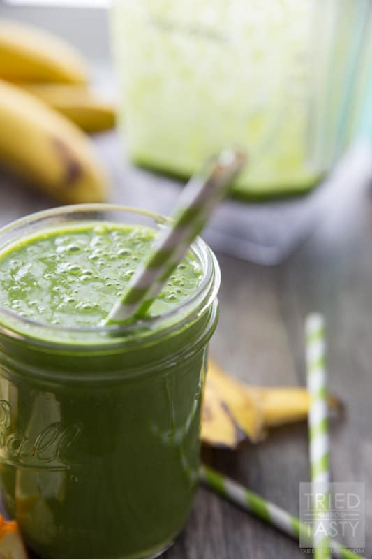 Banana Orange Green Smoothie // Doesn't get any easier than this delicious smoothie! All you need are a few key ingredients and you'll be on your way to a nutrition packed, no-sugar added, simple smoothie. Perfect to jump start your morning. Great for a mid-afternoon pick-me-up. Great for an afternoon snack the whole family will enjoy! | Tried and Tasty