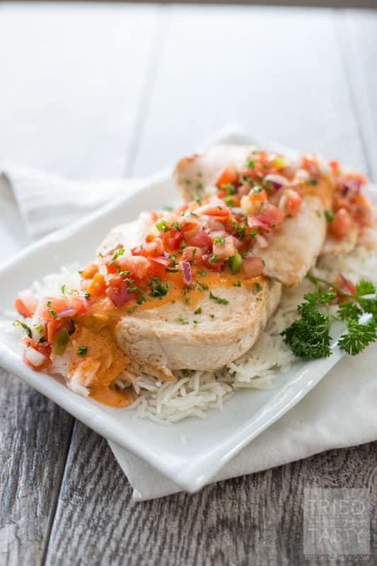 Bruschetta Chicken // Looking for a delicious diner idea for that someone special in your life? This chicken is super easy to whip together and wonderfully tasty. Plus, check out a few other great recipes that will pair nicely to make an entire romantic dinner! | Tried and Tasty
