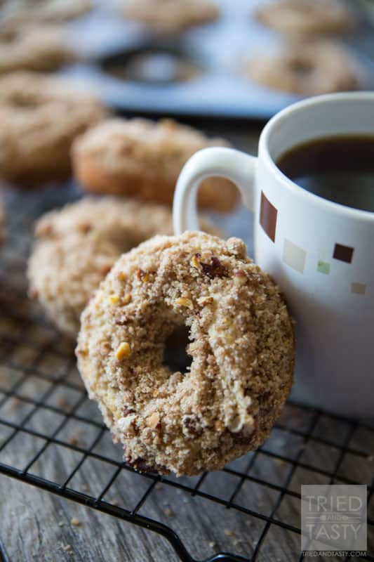 Baked Coffee Cake Doughnuts // You love coffee cake, but do you love coffee cake DOUGHNUTS? The answer is yes. I know. You haven't tried them yet. The answer is still yes. These delicious doughnuts pair perfectly with your coffee for breakfast in the morning. They are a cinch to whip together and will be gone before you know it (better make a double batch to begin with!) | Tried and Tasty