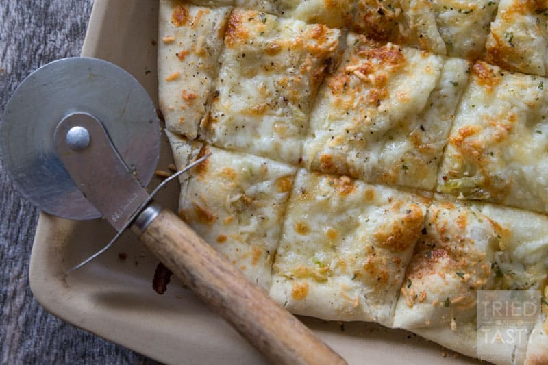 Two Cheese Focaccia // This delicious bread is not only quick & easy, but perfect all by itself OR great to make sandwiches with! Whip this together in no time at all, throw together a turkey & avocado sandwich, then enjoy the perfect lunch! | Tried and Tasty