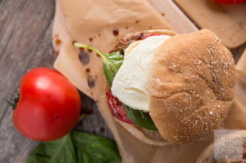 Caprese Burger // 5 Ingredients (plus balsamic vinegar) and you'll be well on your way to the most delicious Italian inspired burger that will wow your tastebuds. This juicy burger is great for any BBQ. Fire up the grill and serve this up all summer long! | Tried and Tasty