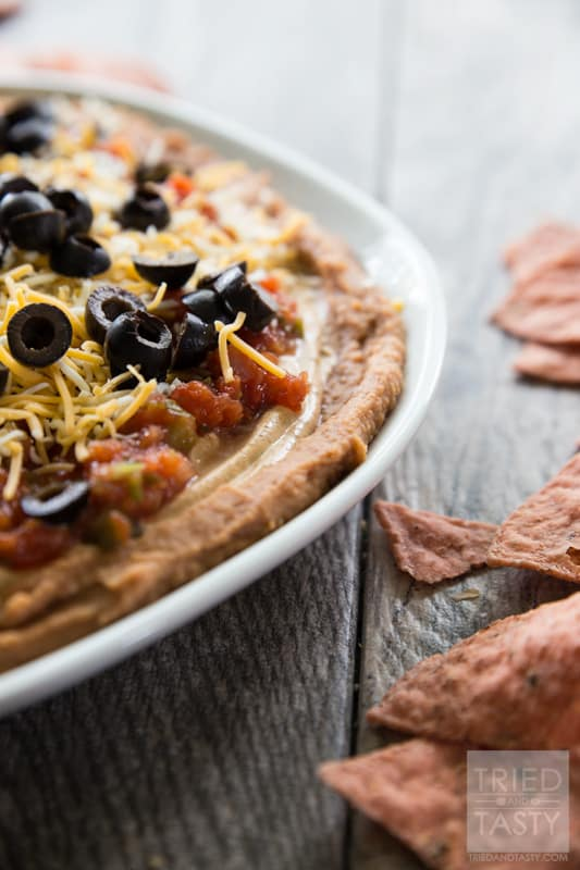 Five Layer Bean Dip // How do you celebrate Taco Tuesday? Cinco de Mayo? Or any other occasion you may be enjoying a Mexican fiesta? May I suggest this delicious bean dip. Not your typical 'seven layer', it's BETTER! Serve with your favorite chips at your next party or get together! | Tried and Tasty
