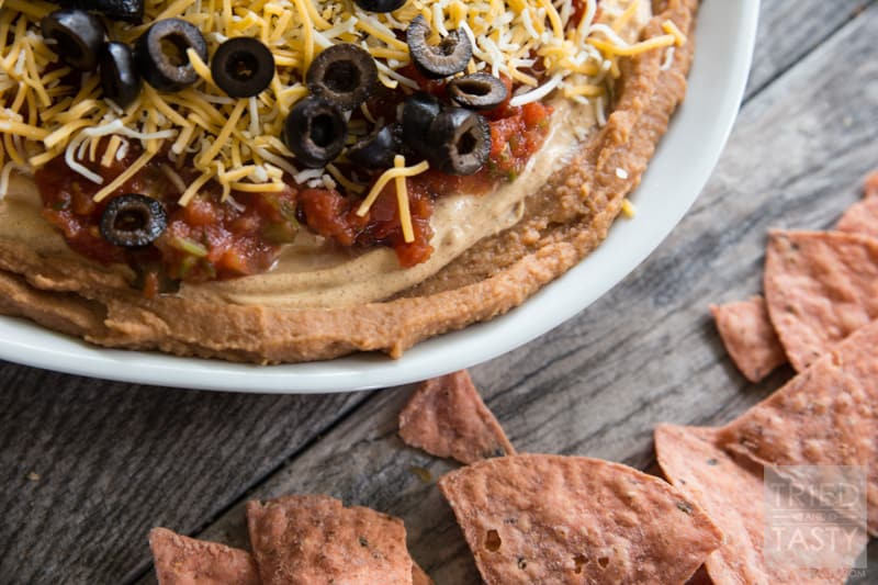 Five Layer Bean Dip // How do you celebrate Taco Tuesday? Cino de Mayo? Or any other occasion you may be enjoying a Mexican fiesta? May I suggest this delicious bean dip. Not your typical 'seven layer', it's BETTER! Serve with your favorite chips at your next party or get together! | Tried and Tasty