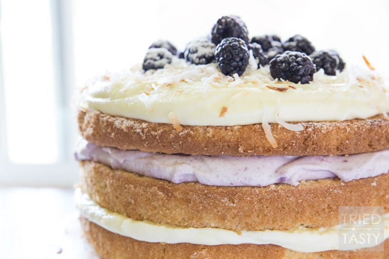 Blackberry Pina Colada Cake // Do you love PIna Coladas? You'll want to get your hands on this fun twist. With the addition of blackberry you've got a next level fruit explosion. The flavors marry together beautifully! | Tried and Tasty