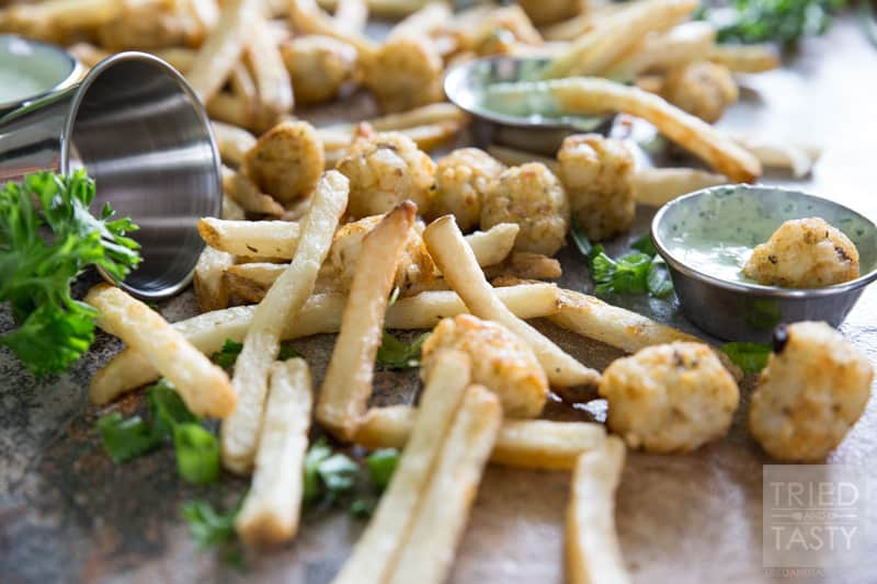 Green Goddess Dip // Tired of traditional ketchup to dip your fries into? This green goddess dip is a refreshing change of pace. Made with fresh delicious herbs - whip it up in your blender and in less than five minutes you'll have the perfect dip to pair with your favorite Alexia fries! (My flavor of choice being the (Crispy Rosemary with Sea Salt & Crispy Seasoned Potato Puffs) | Tried and Tasty