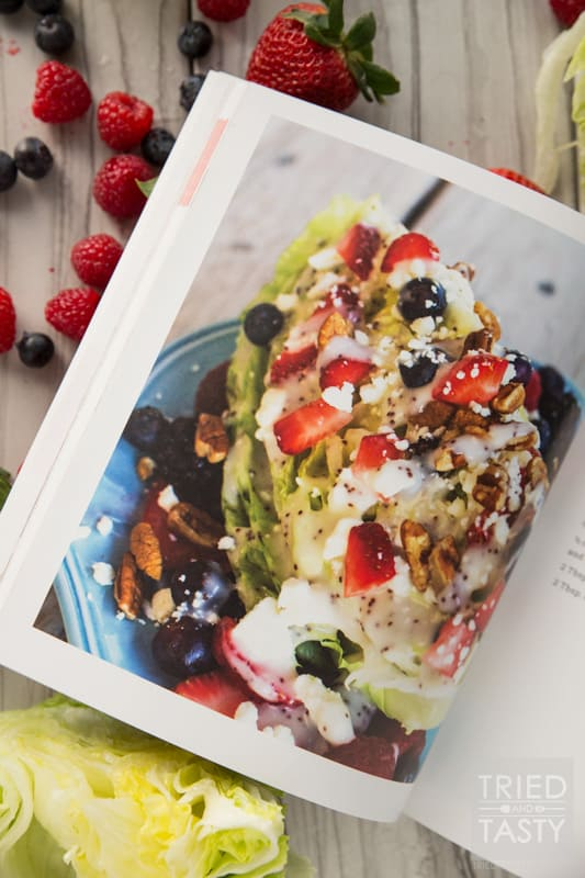 Mixed Berry Wedge Salad // Serve this at your next BBQ! You only need a handful of ingredients including: fresh lettuce, in-season berries, dressing and cheese. The crowd will go nuts with the stunning side dish! | Tried and Tasty
