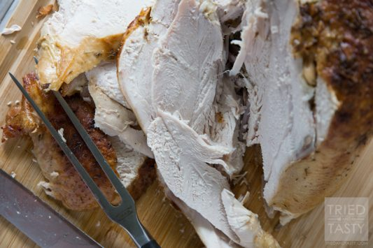 Parmesan Roasted Turkey // Lookiing for a juicy oven roasted turkey with a twist? This Parmesan Roasted Turkey is phenomenal and great for any holiday. Plus, the leftovers make great turkey sandwiches or filling for a hearty soup.   Tried and Tasty