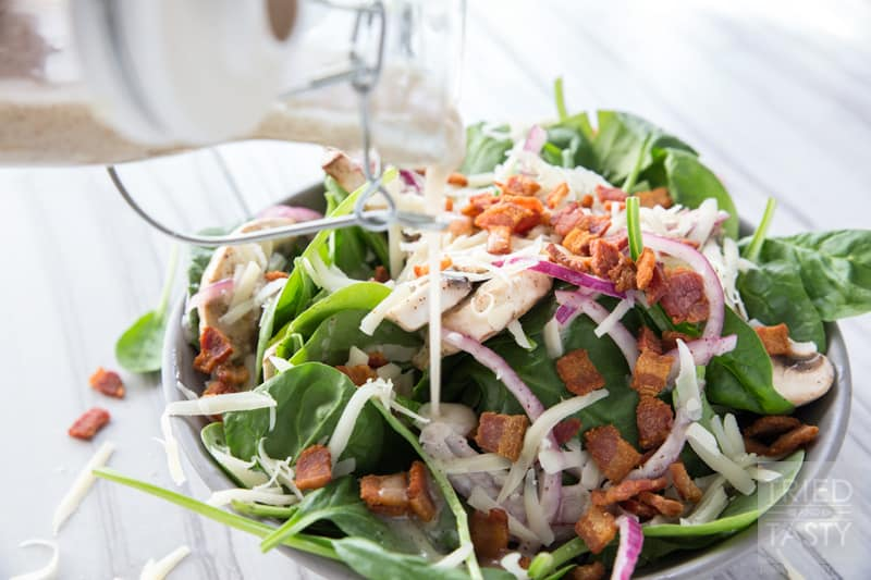 Spinach Salad // You wiill fall in love at first taste with this salad. A delicious combination of so many wonerful flavors. Great addition to any dinner table spread. Great for BBQ's, picnics, potlucks, or holiday parties. Simple to put together! | Tried and Tasty