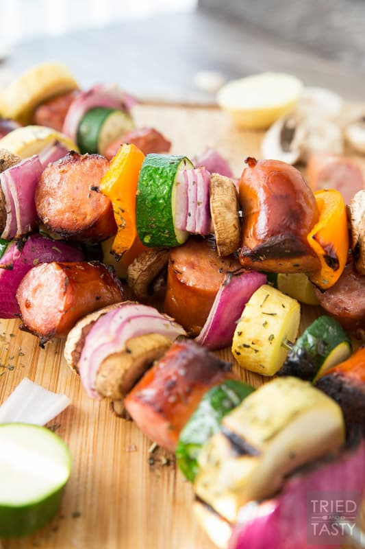 Grilled Sausage & Veggie Kabobs // When temps are rising it's time to take dinner outside. These kabobs are absolutely perfect and completely customizable. Swap in your fav veggies, skewere up your favorite sausage and voila you've got a delicious dinner in only a matter of minutes! | Tried and Tasty