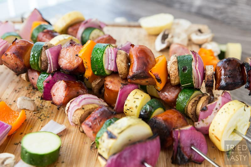 Grilled Sausage & Veggie Kabobs // When temps are rising it's time to take dinner outside. These kabobs are absolutely perfect and completely customizable. Swap in your fav veggies, skewer up your favorite sausage and voila you've got a delicious dinner in only a matter of minutes! | Tried and Tasty