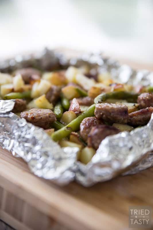 Italian Sausage Tin Foil Dinner // Want a meal that can double as an at-home dinner AND a camping dinner? These tin foil dinners are exactly what you're looking for. Simple to make, flavorful, and ready in 30 minutes. Perfection! | Tried and Tasty