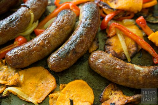 Roasted Brats And Veggies // Celebrate 'Bratsgiving' with this delicious simple meal idea. You probably already have everything on hand, so make this today! | Tried and Tasty
