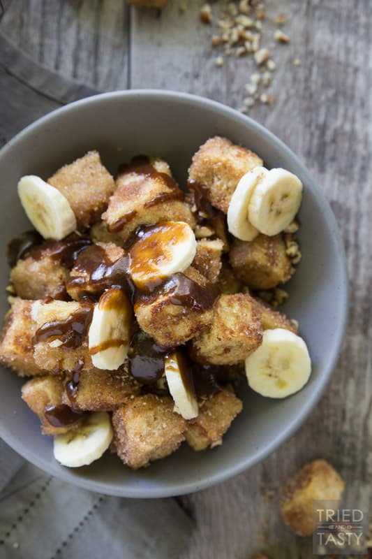 Pumpkin Spice Bananas Foster French Toast Bites // French toast is taken next level with these adorably delicious bites of heaven. You won't believe how wonderfully the flavors come together in this amazing fall inspired breakfast (that can be enjoyed all year long). The best bananas foster breakfast dessert around! | Tried and Tasty