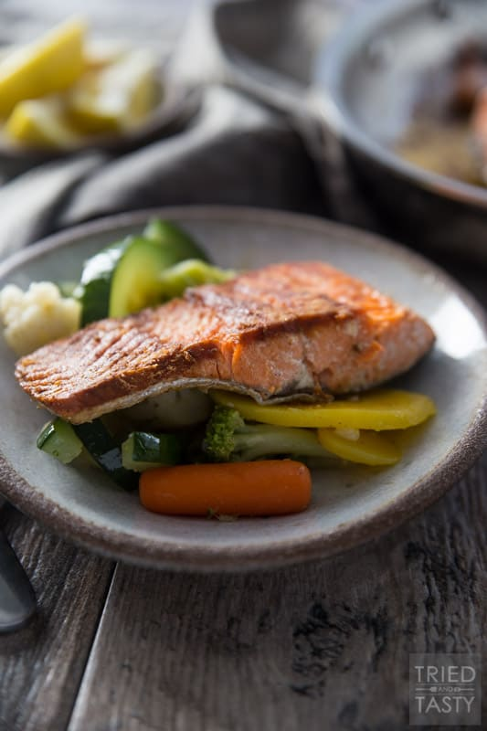 Pan Seared Coconut Oil Salmon and Veggies // This healthy dinner idea is packed with protein and flavor. An excellent meal to add into your rotation. One bite and you'll add it to the rotation week after week! | Tried and Tasty
