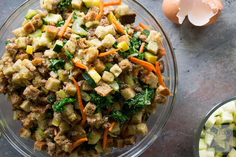 Sausage and Veggie Lovers Stuffing // This hearty and comforting stuffing is perfect for the holidays. Loaded with veggies and mixed with Italian sausage it's the ultimate side dish to add to your turkey, mashed potatoes and dinner rolls. Packed with flavor you're guests will be begging for the recipe. | Tried and Tasty