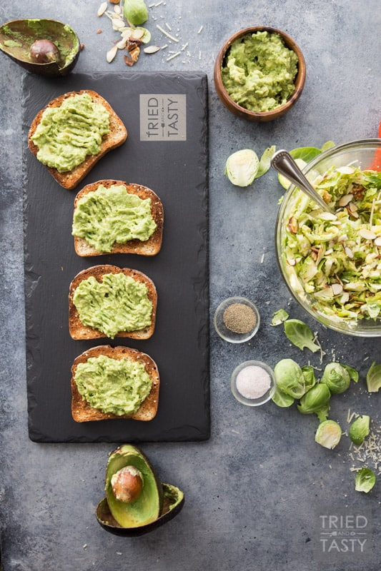 Cheesy Brussels Sprouts and Avocado Toast // Avocado toast is all the rage. However. You haven't had THIS avocado toast before! This will change your life. Even if you don't like avocados you will LOVE this delicious combination. This recipe has everything you want in an avo toast: a little bit of crunch, a little bit of cheese, some veggies and a whole lot of flavor. | Tried and Tasty