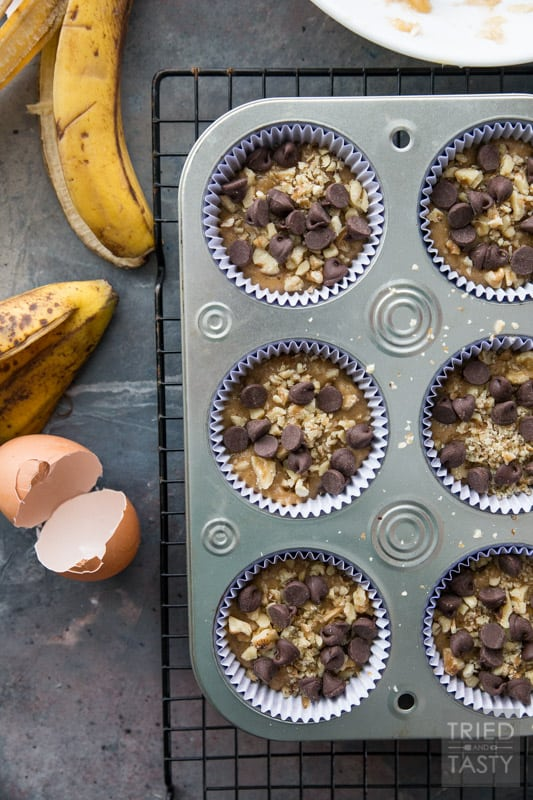 Chocolate Chip Banana Nut Muffins // Words can't describe how delicious these muffins are! You would never guess they were made with whole wheat and without any refined sugar. You'll just have to try them for yourself. Next time you find yourself needing to use up some over-ripe bananas, remember this recipe!   Tried and Tasty