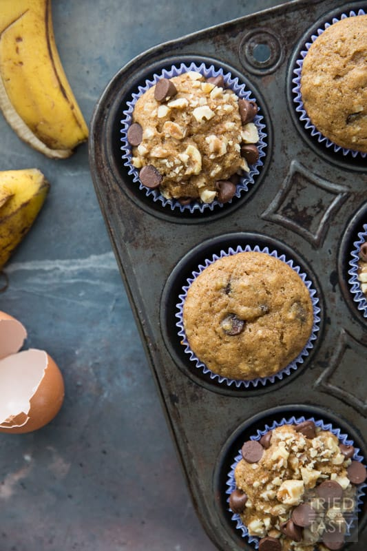 Chocolate Chip Banana Nut Muffins // Words can't describe how delicious these muffins are! You would never guess they were made with whole wheat and without any refined sugar. You'll just have to try them for yourself. Next time you find yourself needing to use up some over-ripe bananas, remember this recipe! | Tried and Tasty