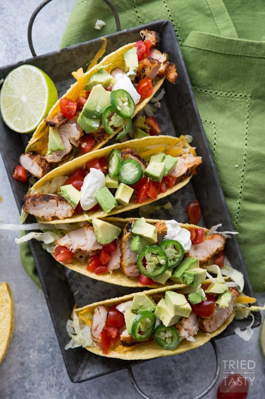 Fire Grilled Chicken Tacos // You haven't had chicken tacos until you've had THESE chicken tacos! This quick and easy weeknight meal will solve your problem to get a meal on the table for those busy nights! You won't believe how tender and flavorful the chicken is! | Tried and Tasty
