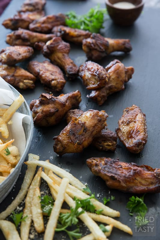 Game Day Wings 'n Parmesan Garlic Fries // Need a game day appetizer? Want some fun finger food that's sure to please a crowd? This power packed combo is sure to give you're guests exactly what they want!   Tried and Tasty
