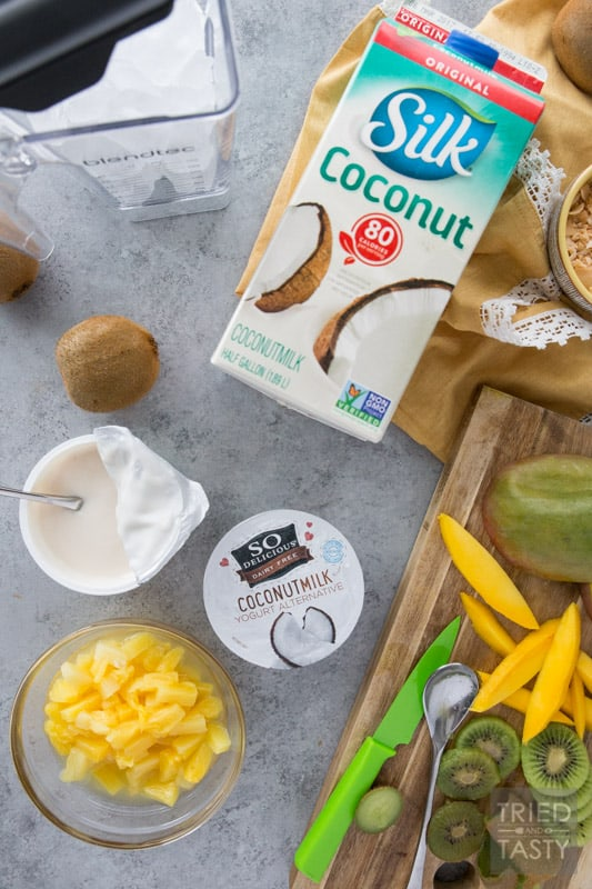 Tropical Dream Smoothie Bowl // The flavors of the tropics blended together into this delicious dairy-free smoothie bowl. If you're wanting to be transported to a warm and sunny vacation spot, this bowl makes you feel like those dreams are a reality! | Tried and Tasty