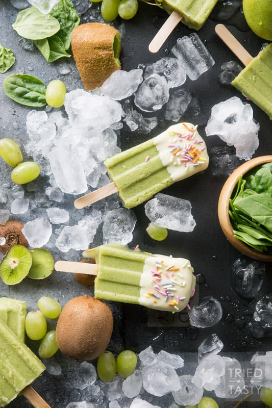 White Chocolate Dipped Kiwi Popsicles // Want a treat and want it to be healthy? These popsicles are exactly what you are looking for. Just blend, freeze, dip & enjoy! Made with the most delicious fruits and no added sugar! | Tried and Tasty
